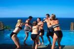 Women Pushing Men into Swimming Pool